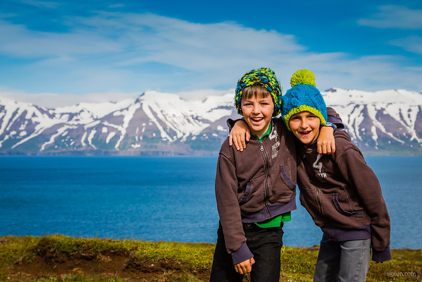 This picture looks cold since the boys are wearing hats and the mountains in the background have snow but this picture is from a warm July day in Northeast Iceland - you still need to wear a sweater most of them time and sometimes hats too when there is a cold breeze from the Atlantic Ocean.