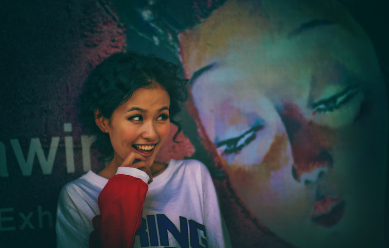 """<h2>Random Sighting in Beijing</h2> <br/>I was walking around the arts district in Beijing and saw this cute girl posing up against a wall for her friend. After I was sneaky and took this photo, she looked over and gave me an even bigger smile! hehe… I notice sometimes that girls over there take a lot of photos of each other and act silly. And then, whenever I swoop in and take a picture, they get even sillier. It's a very strange phenomenon but it's always fun.<br/><br/>- Trey Ratcliff<br/><br/><a href=""""http://www.stuckincustoms.com/2013/02/03/random-sighting-in-beijing/"""" rel=""""nofollow"""">Click here to read the rest of this post at the Stuck in Customs blog.</a>"""