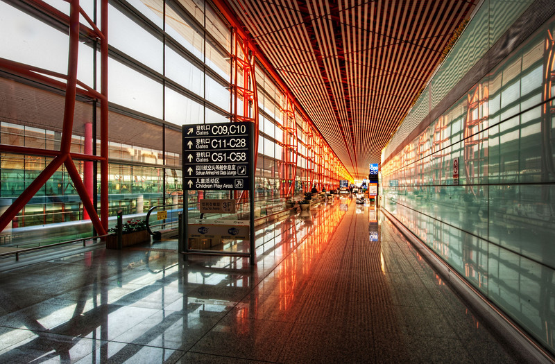 """<h2>Airports in China</h2> <br/>Asian airports are some of the best in the world, eh? <br/><br/>These architects must love designing them... they get to go crazy and try all kinds of experimental things.  Not only are they huge, but the inventive lines and shapes make them virtually inexhaustible subjects for photography!<br/><br/>This shot was taken further inside the Beijing (PEK) airport as you are approaching the gate. I kept my tripod as carry-on here for a few reasons. First, so I could take photos in the airport. Second, so I would have it at landing just in case my bag was lost! That happened in Argentina once and I haven't repeated that mistake since…<br/><br/>- Trey Ratcliff<br/><br/><a href=""""http://www.stuckincustoms.com/2011/10/07/airports-in-china/"""" rel=""""nofollow"""">Click here to read the rest of this post at the Stuck in Customs blog.</a>"""