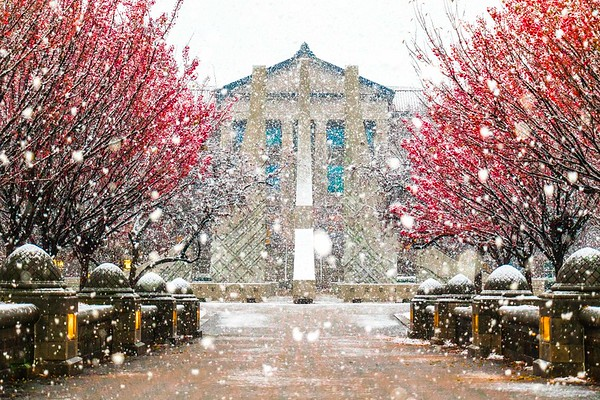 Snow falling around the Engineering Fountain at Purdue University