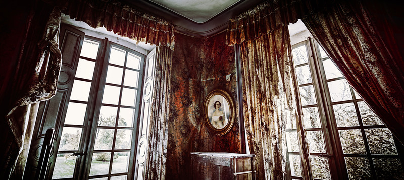 "<h2>Where the Bloody Walls Screamed</h2> <br/>Here is one of the many ill-forgotten and scary rooms in the chateau. Some were fully furnished and perfect, but others had fallen apart after years of neglect. Here is one of those many incredible rooms!<br/><br/>- Trey Ratcliff<br/><br/><a href=""http://www.stuckincustoms.com/2012/11/26/where-the-bloody-walls-screamed/"" rel=""nofollow"">Click here to read the rest of this post at the Stuck in Customs blog.</a>"