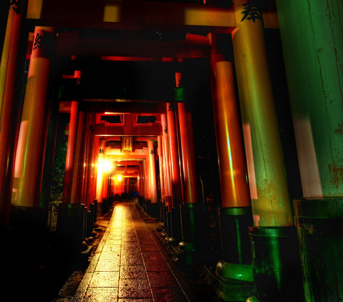 "<h2>1,000 Red Gates</h2> <br/>What a wonderful and unique place on earth this is! In Kyoto, Japan, there resides the unique shrine of Fushimi Inari. It consists of thousands of red gates that wind up and down the mountain. I walked through it deep into the night…. I was the only one around and it was downright eerie. Every now and then, the gates would stop and there would be a mini-shrine off to one side or a graveyard to another. Both of these added to the creep factor.<br/><br/>I had a serious worry about an hour into the hike through these gates — what if they turn off the lights? I had no flashlight! I considered my two options — I could strobe my SB-800 to find my way out, which would be a totally surreal experience through these gates. Or, I could do what one of my Israeli hiker friends did in Argentina, use the back of my camera display for light (he actually used his to set up his tent)!<br/><br/>- Trey Ratcliff<br/><br/><a href=""http://www.stuckincustoms.com/2010/01/28/1000-red-gates/"" rel=""nofollow"">Click here to read the rest of this post at the Stuck in Customs blog.</a>"