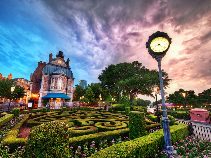 """Beautiful Disney World at Sunset Hey, you know... I can't stay mad at Disney for too long.  I think those issues are just at Downtown Disney.This photo below, from Epcot, is one of the reasons I keep coming back again and again.  It's such an amazing place, and Epcot may be my favorite new spot for photography at Disney.This is the """"France"""" area of the World Showcase, which is a huge lake that is circumnavigated by about 10 different countries or so.  Each one has a cluster of buildings set in the theme of the country.  They are all quite authentic, and the areas are staffed with people from the countries.  The Norway area has authentic-looking and -sounding Norwegians.  The Germany area is filled with Germans in postcard-German-clothes.  The Canada area has people that look and sound like Americans.The afternoon had ripped open a wicked thunderstorm on the whole park.  It was subsiding around sunset, so the clouds were swirling about with these wonderful tempestuous formations.  I set up to take this shot before moving over to the Japanese area to watch the big fireworks show on the lake.  While I was taking these shots, by the way, I had sent my family into one of the pastry shoppes here in the France area to load up on wonderful little morsels to keep us fully loaded during the fireworks show!- Trey RatcliffClick here to read the rest of this post at the Stuck in Customs blog."""