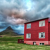 """<h2>Green Mountain, Red House</h2> """"Is the house really THAT red?"""" my wife asks me.  Yes, oh yes, it is...  But now I am taking her to Iceland with me, so she can see these bright colors for herself...  I don't know if it's a Scandinavian thing or what, but we just don't see colorful houses like this in the states.  I think we either have brick, or white, or slightly off-white, or perhaps a light beige, or maybe something daring like a mauve-eggshell-white...  I mean, I'm just as bad... mine in stucco.  I don't even think my homeowner's association would let me paint it red.  But, knowing Austin, with a bright red house, we'd probably have a few commies show up in Che Guevara shirts, wondering where the free pizza is...  - Trey Ratcliff  Read more <a href=""""http://www.stuckincustoms.com/2011/06/15/green-mountain-red-house/"""">here</a> at the Stuck in Customs blog."""