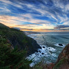 "<h2>Big Sur in the Morning</h2> <br/>5:30 AM.  Alarm goes off.  It's always painful.  People that say they are ""morning people"" -- I think they are lying.  But, when in a beautiful place, I always force myself, military style, to pop out of bed.  There are hikes to be made and photos to take!<br/><br/>I stayed at the Ragged Point Inn.  My room had a little fireplace and everything (which made it even harder to get out of bed!).  After I got downstairs, I started a little hike to get a good vantage of the coast and the sunrise.  Of course, there was a fence blocking the best bit, so I jumped over it like Carl Lewis (a much older, whiter, and less jumpy Carl Lewis), and edged along the rocky coast to get a good spot.  I forgot to put on my hiking shoes and mistakenly donned my Cole-Haans while in the dark.  Big mistake.  Those don't make for good hiking shoes, especially after five minutes of getting soaked in morning dew from the foliage I was ripping my way through.<br/><br/>But, I had on my earphones and was blasting away music...  all was good... the sun came up, the clouds were perfect, and I took this photo.<br/><br/>- Trey Ratcliff<br/><br/><a href=""http://www.stuckincustoms.com/category/travel/california/big-sur/"" rel=""nofollow"">Click here to read the rest of this post at the Stuck in Customs blog.</a>"