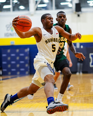 TORONTO, CANADA - Dec 01: during OCAA Mens Basketball Match between Humber Hawks and St Clair College at Humber Hawks Athletics Gym. Photo: Michael Fayehun/F10 Sports Photography