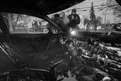 Suffolk County Police work to expose the VIN on a vehicle that was set on fire by a robbery suspect. 11-29-2020