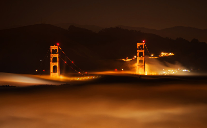 """<h2>San Francisco in the Fog</h2> <br/>SF would not be the same without the fog, would it? It's part of the city, like the wind in Chicago. But the wind in Chicago kinda sucks, so I guess that is a bad analogy. Maybe a better one is it's like the water in Venice or the neon in Vegas.<br/><br/>I took this photo from the top of Twin Peaks with a 28-300mm lens. I think it's probably the best spot to take this photo because of the black background behind the bridge. If you shoot it from the other side, then you get the city behind it. Of course, that can be cool too – it's just a different sort of shot.<br/><br/>- Trey Ratcliff<br/><br/><a href=""""http://www.stuckincustoms.com/2012/11/01/san-francisco-in-the-fog/"""" rel=""""nofollow"""">Click here to read the rest of this post at the Stuck in Customs blog.</a>"""