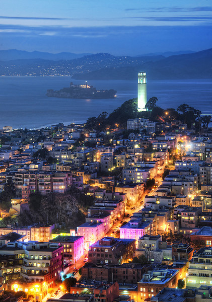 """<h2>Alcatraz in the Dusk</h2> Today's photo was taken recently in San Francisco.  That tower you see there in the mid-distance is Coit Tower.  Just beyond that, in the middle of the bay, you can see Alcatraz.  I've never made it out to Alcatraz to take photos, but it is on my list.  I wonder how much freedom (!) I would have out there to roam around with my tripod.  Have any of you gotten out there?  - Trey Ratcliff  Read more <a href=""""http://www.stuckincustoms.com/2011/12/08/big-live-hangout-tonight/"""">here</a> at the Stuck in Customs blog."""