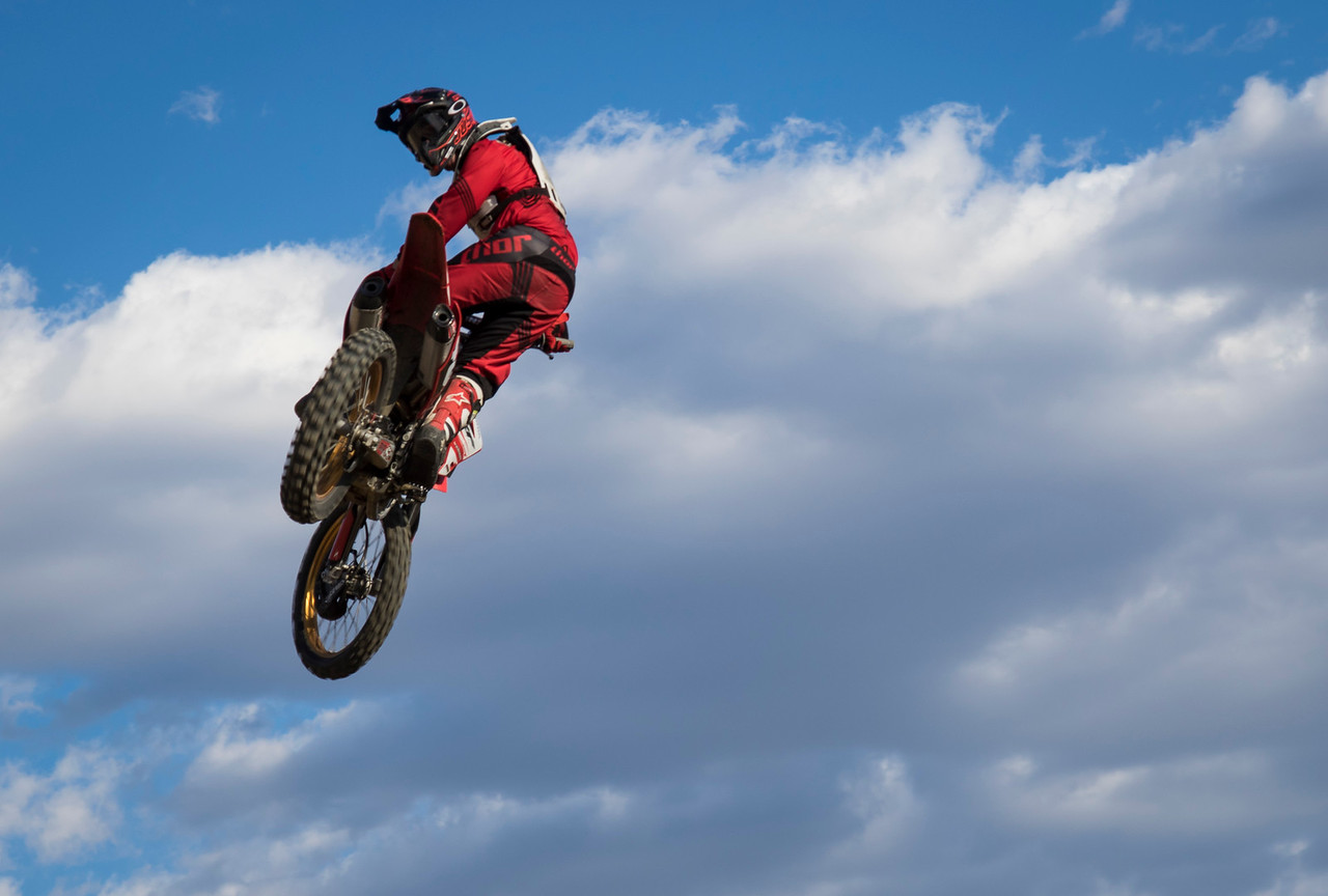 On the Wednesday afternoon of Oct. 21, 2015, Sean Carrol is whipping over a huge tabletop jump with style at Piru Motocross Park in Piru, Calif. (© Erica Jacques 2015)