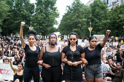 (From left to right) Sophia Byrd, Eva Lewis, Natalie Braye, and Maxine Wint lead a Black Lives Matter Chicago youth sit-in rally at Millennium Park  on July 11, 2016. | Colin Boyle for Chicago Magazine https://www.chicagomag.com/city-life/July-2016/Black-Lives-Matter-Chi-Youth-Sit-In-Rally/