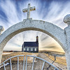 "<h2>Miracle in Iceland</h2> <br/>I knew if I took enough HDR pictures of churches that I would eventually get a miracle. You know, the odds are technically and scientifically in my favor. The sound the miracle made was about the same sound as when they hit that emergency switch in the hatch on Lost.<br/><br/>This one was a five-exposure HDR. The cloud streaks were subtle, but nice, and the tone mapping certainly helped them to pop.<br/><br/>This was taken from inside the cemetery, whose egress was made through this nice little white gate.<br/><br/>- Trey Ratcliff<br/><br/><a href=""http://www.stuckincustoms.com/2007/03/17/miracle-in-hdr/"" rel=""nofollow"">Click here to read the rest of this post at the Stuck in Customs blog.</a>"
