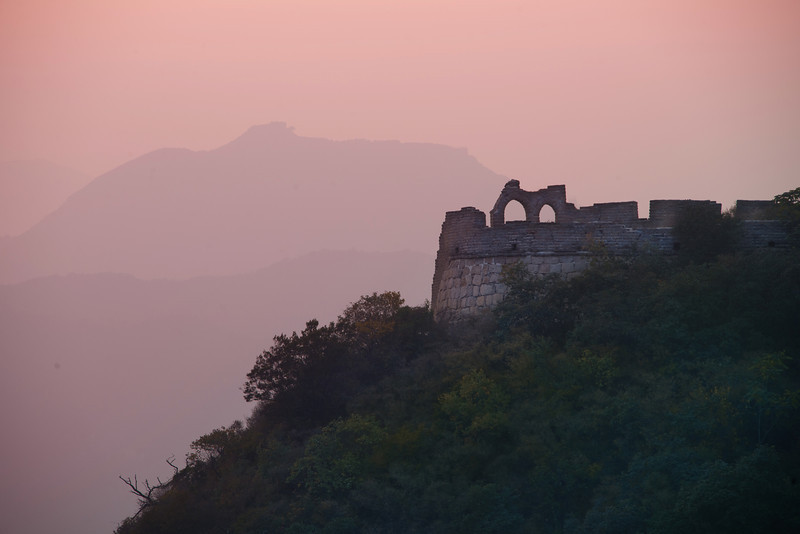 Great Wall in Evening Light  When I was at the Great Wall that evening, I kept hiking along the old wall as the sun set. I also had a zoom lens (28-300mm) with me, so I was able to get in tight on far away structures and shapes. Not too long after I took this shot, I walked along several lengths of the wall to get to these ruins. I stood there for a long time listening to music and taking photos.  - Trey Ratcliff  Read more (and see a new video) here at the Stuck in Customs blog.