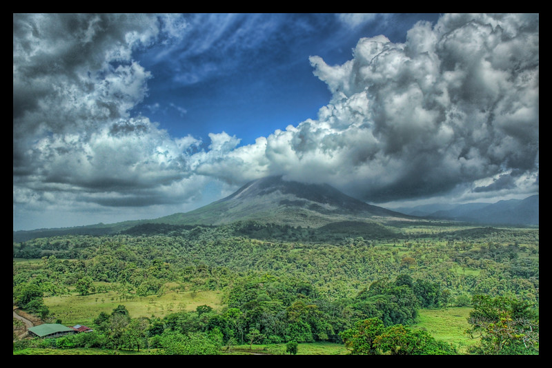 "<h2>The Arenal Volcanic Plume</h2> <br/>I took this one from about 10 km from the west side of the dam that forms lake Arenal at the base of the volcano. I had the tripod set up for several hours trying to wait for the clouds to arrange themselves in the right way. The good thing was that it was so windy the whole scene changed every five minutes.<br/><br/>- Trey Ratcliff<br/><br/><a href=""http://www.stuckincustoms.com/2006/04/30/volcano-picture-makes-flickr-front-page/"" rel=""nofollow"">Click here to read the rest of this post at the Stuck in Customs blog.</a>"