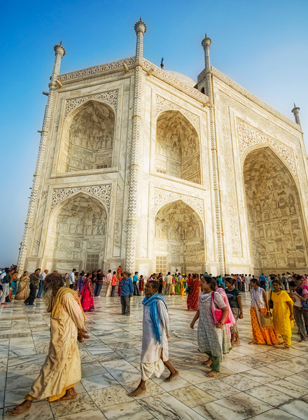 """<h2>A Godly Dance at the Taj</h2> <br/>I was barefoot like the rest of them.<br/><br/>The day must have been around 95 degrees and as stuffy as can be, but the cool marble seemed to keep me from being drenched in sweat.  After a long walk, I had finally made it to the inner core of the Taj Mahal, around the main tomb structure where pilgrims from all over the country had gravitated.  The faithful coiled in long lines and snaked their way around the complex, waiting patiently to reflect at the megamausoleum and communing with the god of their choice.  How could a billion people be wrong?<br/>When I travel, I actually always enjoy talking to Indians (or whoever) about their religion.  Here is a little thing I do... I'm not sure it's totally ethical since I say the same thing over and over, but I enjoy seeing people's reaction as a probe a panoply of personalities.  Inevitably, when I'm in a taxi or man-powered trike-mobile, there is some sort of deity that is jiggling about on the dashboard or handlebars.  It can be anyone from Shiva to Brahma to Vishnu to Krishna to Ganesha and beyond.<br/><br/>So, I always ask, """"Who is the god to whom you pay reverence?""""<br/><br/>They respond quickly and directly, usually naming one from of the top ten from the pantheon of possibilities.<br/><br/>I respond back, in all seriousness, """"Oh!  He is a <em>very</em> powerful god!""""<br/><br/>To this, they always turn to me and nod gravely.<br/><br/>My guide there was from no from one of the traditional Hindu sects -- he was a Jain.  The Jain don't recognize the divine origins of the Vedas (made popular in the US from Oppenheimer's re-quote after testing the Bomb), nor do they believe in any one supreme deity.  They instead revere Tirthankaras who have raised themselves to divine perfection.  So anyway, if you ever try out the little trick above, don't bother with a Jain because they will just give you a funny look and a wobble of inconsequential solitude.<br/><br/>So if any of you get the ch"""