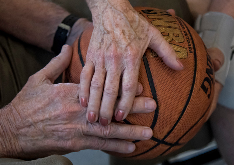 On July 14, 2015 in St Paul, Minn. This couple is holding a basketball while the National Senior Games Association has several basketball competitions at University of St Thomas. (© Erica Jacques 2016)