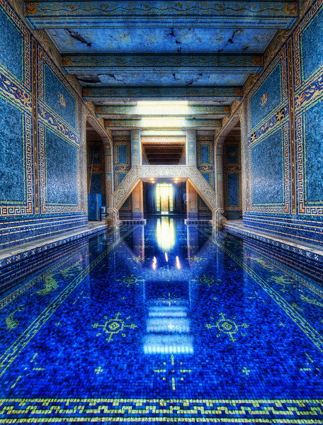 """<h2>The Azure Blue Indoor Pool at Hearst Castle</h2> <br/>I was able to get a private tour throughout Hearst - so that made for an amazing and long day!Thank goodness I had a mass of memory cards... I got so much footage it was crazy!<br/><br/>I could have picked a bunch of shots to be the """"first"""", but I thought this one was particularly wonderful.  There are two enormous pools at Hearst Castle, and this is the indoor one.  This is a nice vantage point because this spot is actually quite difficult to reach!  There is no door behind me... so I had to """"shimmy"""" along that edge you see... It was NARROW... the shimmy was like a video game, except while holding a $10,000 camera!  Sketchy!  But I just had to get over here because I could visualize the shot before it happened...<br/><br/>Here's a cool fact about this pool.  Nearby, there is a huge room that was intended for a gymnasium that Hearst never constructed.  The State then made it usable for IT and Archive area, so the water cools the computers...  wild, eh?<br/><br/>- Trey Ratcliff<br/><br/><a href=""""http://www.stuckincustoms.com/2010/02/01/the-azure-blue-indoor-pool-at-hearst-castle/"""" rel=""""nofollow"""">Click here to read the rest of this post at the Stuck in Customs blog.</a>"""