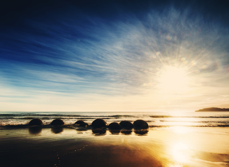 """<h2>Moeraki Boulders at Uber Sunrise</h2> <br/>These Moeraki boulders are awesome in the morning! If you are going to visit this place, I suggest you get online and check a few things:<br/><br/>1) Check the tides. Make sure there will be low tide in the morning.<br/>2) Check the sun position and time for the year.<br/><br/>If you get those two things planned out, then you can go and spend the night there in Moeraki. You don't want to go through all the trouble of getting into position if the conditions are wrong.<br/><br/>- Trey Ratcliff<br/><br/><a href=""""http://www.stuckincustoms.com/2013/04/13/moeraki-boulders-at-uber-sunrise/"""" rel=""""nofollow"""">Click here to read the rest of this post at the Stuck in Customs blog.</a>"""