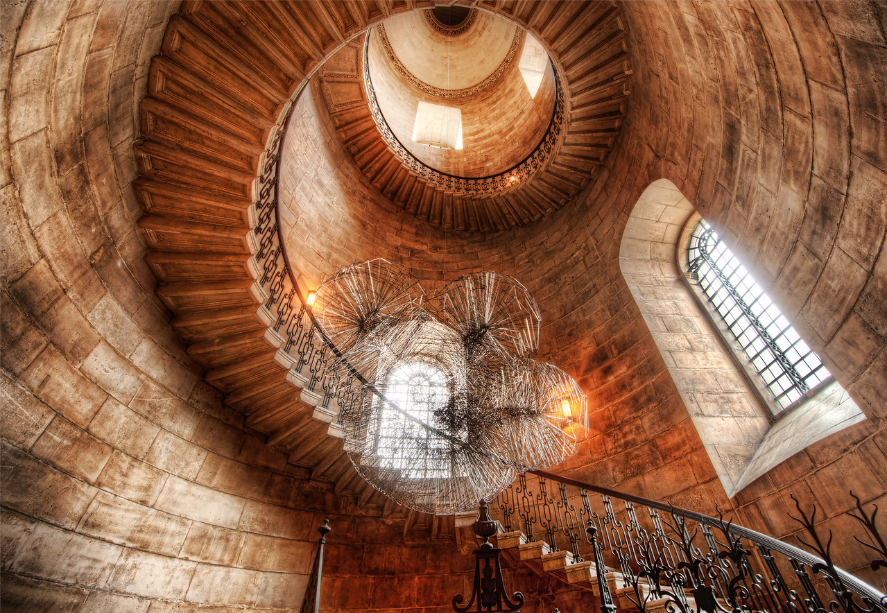 Spiralstorm This beautiful staircase was found in a small cloister while I was about to exit St. Paul's Cathedral in London.  I took some extra time while I was over there for the workshop to explore places like this.  There were only a few days extra, but I tried to make the most of it.I got shut down a few times while in the proper part of the cathedral, but I did manage to get a few shots in.  As for this area, it was wide open and no one said anything.  I always feel more comfy when I am not rushed and have time to set everything up!  In this case, I used a 14-24 lens.  I get asked a lot if I use filters on my lens -- but I do not.  I don't even know if you can get a filter that fits this bulbous wide angle.- Trey RatcliffClick here to read the rest of this post at the Stuck in Customs blog.