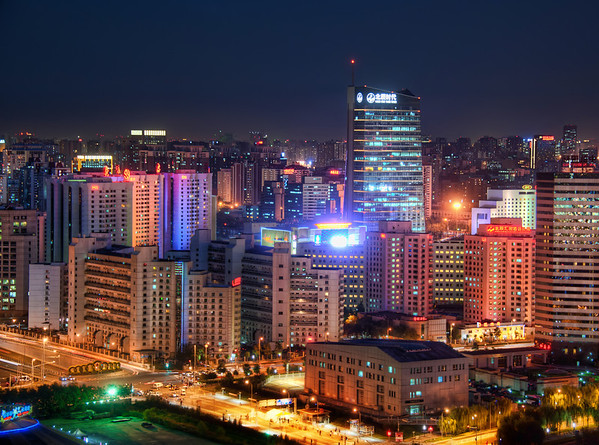 """Little Beijing While at the top of one of new towers built for the Olympics, I was able to get a good vantage back towards different parts of the city.  Beijing is so spread out -- there does not seem to be a central focus in the traditional """"skyscraper"""" sense.  I've taken a few other downtown shots you might recall (click on the""""Beijing"""" category), but this spot was kind of cool and unique because of this tower I was in.I happened to be outside with Joe McNally, after we finally convinced the officials to let us get beyond the inside and dirty windows.  We were out in the """"5th ring"""" where many Olympic venues were built.  And so, here was this huge tower in the outskirts, looking back towards the city.  It seemed like a good situation for a zoom-in compression shot.- Trey RatcliffClick here to read the rest of this entry at the Stuck in Customs blog."""