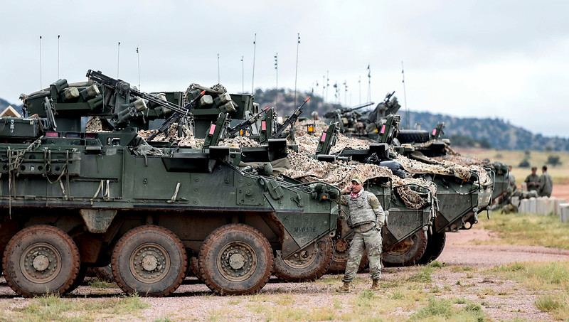 A member of the opposition force waits for other Stryker armored vehicles to pull in at a training exercise at Camp Red Devil in Fort Carson, Colo. on Sunday, Sept. 24, 2017. The opposition used the strikers to assault the 2nd Brigade's position during part of the exercise.<br /> <br /> (The Gazette, Nadav Soroker)