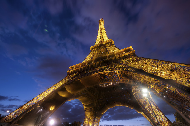 "<h2>Under the Eiffel</h2> <br/>This time of night only lasts a fleeting five minutes.  So, as a photographer in Paris, it's a major commitment to get in place for that dire period.  There's never an easy decision, and... after all... it is Paris, so there is no ""bad"" place to be.<br/><br/>I'm glad it's a city where many restaurants stay open late.  I miss the ""normal"" dinner time, since those are the prime sunset hours.  I usually try to grab a snack around 4 PM to carb-up for a busy shooting session.  And then after I eek out every last minute of atmospheric light, I like to go to a late-night restaurant to edit photos and relax a little bit.  Okay, actually I relax a lot.<br/><br/>- Trey Ratcliff<br/><br/><a href=""http://www.stuckincustoms.com/2011/01/30/eiffel-towe/"" rel=""nofollow"">Click here to read the rest of this post at the Stuck in Customs blog.</a>"