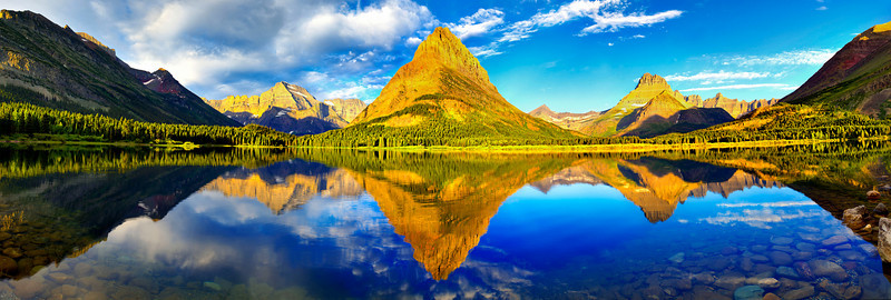 "<h2>The Majesty (my largest photo ever)</h2> <br/>This is one of the largest pieces I have ever made; the giant TIFF is about 21,000 pixels across.  I shot it one cool and crisp morning at Glacier National Park in this crystal clear lake that is fed by glacial runoff.  It is comprised of 90 different photos that took a small eternity to mix together into an epic HDR.  I've been thinking about having a 10-foot mural printed at walk-up resolution... but I am not quite sure where I would put it!<br/><br/>- Trey Ratcliff<br/><br/><a href=""http://www.stuckincustoms.com/2008/09/27/the-majesty-my-largest-photo-ever/"" rel=""nofollow"">Click here to read the rest of this post at the Stuck in Customs blog.</a>"