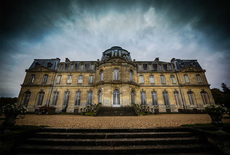 "<h2>The Dramatic Chateau</h2> <br/>I took photos of this side of the chateau twice. Once in the morning when the clouds were heavy, and once again in the afternoon when the clouds parted. I ended up liking this cloudy one better. There was a bit of a natural vignette, but I decided to enhance that a bit in the post processing.<br/><br/>- Trey Ratcliff<br/><br/><a href=""http://www.stuckincustoms.com/2013/04/28/the-dramatic-chateau/"" rel=""nofollow"">Click here to read the rest of this post at the Stuck in Customs blog.</a>"