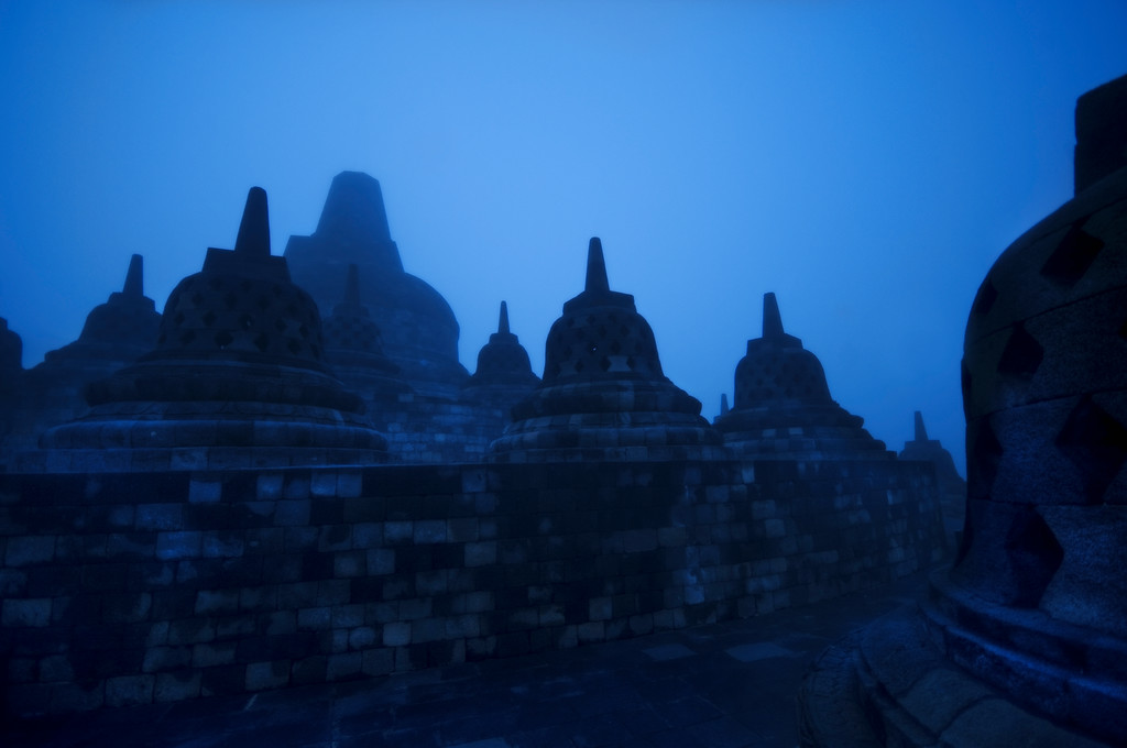 """The Bellweathers Today, we're showing a new photo from Indonesia - the unique temple of Borobudur.   This was taken prior to sunrise, when a thick layer of damp fog covered the mountain lowlands, where this temple is located outside of Jogjakarta.  It was one of those very wet mornings when there is really no appropriate attire.  It's not too cool and not too hot - but just """"uncomfortable.""""  I was listening to my music to make me forget about that nonsense though...  it helped quite a bit! - Trey RatcliffClick here to read the rest of this post at the Stuck in Customs blog."""