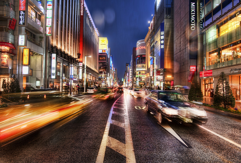 """<h2>Ginza, Tokyo in the Rain</h2> <br/>It had been raining all afternoon and it continued right through dusk.  Luckily, the D3X seems impervious to rain, ice, sleet, and snow (deep experience in all four), so I just ignored all the elements in this case too.<br/><br/>Ginza is a really cool, upscale area of Tokyo.  The buildings are huge and gleaming with every possible color.  It comes alive right at dusk.  I ran out into the middle of the street to do my best to capture all the action of the scene.<br/><br/>- Trey Ratcliff<br/><br/><a href=""""http://www.stuckincustoms.com/2010/04/26/ginza/"""" rel=""""nofollow"""">Click here to read the rest of this post at the Stuck in Customs blog.</a>"""