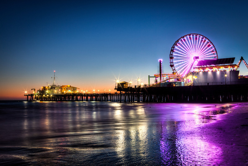 "<h1>Santa Monica Pier</h1>  <p>A popular photo spot, I wanted to take a photo of this location that I've never seen before. This is a long exposure HDR. As the tide pulls back the wet sand casts a very nice reflection of the lights from the amusement park.</p>  <p>Read more about this <a href=""http://alikgriffin.com"">HDR Photo of the Santa Monica Pier.</a></p>"