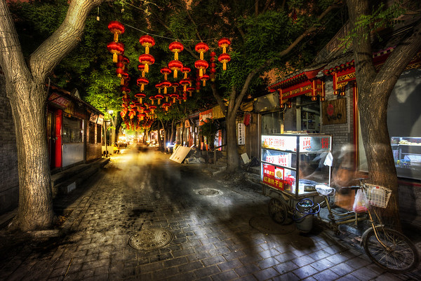 Dark Street with Lanterns in China Here's another night scene from China a few weeks ago. I'm always a sucker for these Chinese lanterns. They just always seem so authentic, even though I am sure that most of the time they are just strange anachronisms and no longer the most efficient way to light up the area. But, as far as anachronisms go, it's one of my favorites!- Trey RatcliffClick here to read the rest of this post at the Stuck in Customs blog.