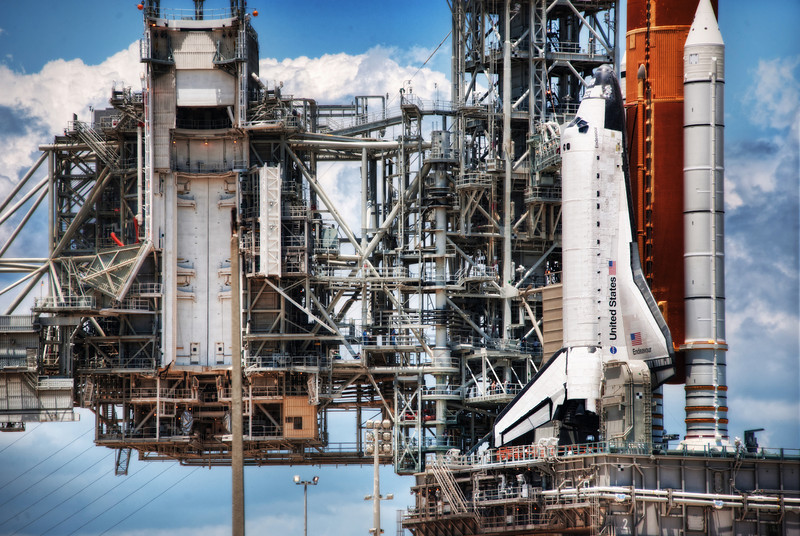 """<h2>The Shuttle Machine</h2> <br/>I went out to the launchpad during the """"retraction event"""" which is quite exciting. Well, it's kind of exciting because it's all in slow motion. The unit retracts very very slowly – so slowly you barely even notice it. The whole thing takes over an hour, but it's still pretty cool.<br/><br/>About halfway through, I got the feeling that the shuttle was intertwined into this huge, hulking machine, and that is when I grabbed this shot.<br/><br/>- Trey Ratcliff<br/><br/><a href=""""http://www.stuckincustoms.com/2012/08/25/the-shuttle-machine/"""" rel=""""nofollow"""">Click here to read the entire post at the Stuck in Customs blog.</a>"""