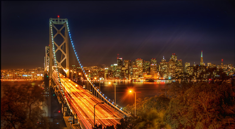 """A Dishonest Image of San Francisco And with this image, I am once again launching full-out-assault on the hallowed traditions of photography. You know what I did with this image? I post-processed it! Oh yes, I really did. And I had so much fun doing it… at least as much fun as Dexter in his kill room.I guess if I was to be really """"honest"""" and take a photo of San Francisco and keep with the tradition of the greats of photography, it would have to be black and white photo, right? I mean, the world really is black and white, isn't it? Oh wait, no… it's in color. Wait, now I'm confused.Oh no, look what I've done now. I've gone and upset people that think one form of artistic expression is superior to another form of artistic expression. How could I be so callous and open with my thoughts and techniques?- Trey RatcliffClick here to read the rest of this post at the Stuck in Customs blog."""