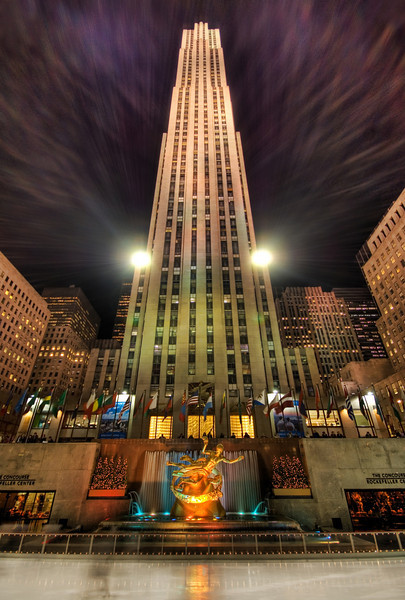 """<h2>Ice Skating at Rockefeller Center</h2> <br/>After I went to the top, I visited the bottom of Rockefeller center, where the famous ice-skating rests.  The huge lights on both sides of the tower created a cool purple streaming light that exploded out of both sides of the building, making for a very cool effect (at least I think so!).<br/><br/>- Trey Ratcliff<br/><br/><a href=""""http://www.stuckincustoms.com/2007/05/16/ice-skating-at-rockafeller-center/"""" rel=""""nofollow"""">Click here to read the rest of this post at the Stuck in Customs blog.</a>"""
