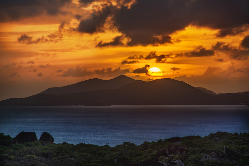 """<h2>The Golden Disc Descends Behind the Island</h2> <br/>I could watch one of these every night I think!<br/><br/>It is hypnotic, isn't it, watching this massive fireball slowly dip into the sea? I notice that the sun seems even bigger when there is another object of significance in the distance. You can't always plan for that, but it sure is nice when it happens.<br/><br/>I took these photos from the balcony at Amaterus.<br/><br/>- Trey Ratcliff<br/><br/><a href=""""http://www.stuckincustoms.com/2012/10/14/the-golden-disc-descends-behind-the-island/"""" rel=""""nofollow"""">Click here to read the rest of this post at the Stuck in Customs blog.</a>"""