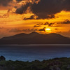 "<h2>The Golden Disc Descends Behind the Island</h2> <br/>I could watch one of these every night I think!<br/><br/>It is hypnotic, isn't it, watching this massive fireball slowly dip into the sea? I notice that the sun seems even bigger when there is another object of significance in the distance. You can't always plan for that, but it sure is nice when it happens.<br/><br/>I took these photos from the balcony at Amaterus.<br/><br/>- Trey Ratcliff<br/><br/><a href=""http://www.stuckincustoms.com/2012/10/14/the-golden-disc-descends-behind-the-island/"" rel=""nofollow"">Click here to read the rest of this post at the Stuck in Customs blog.</a>"