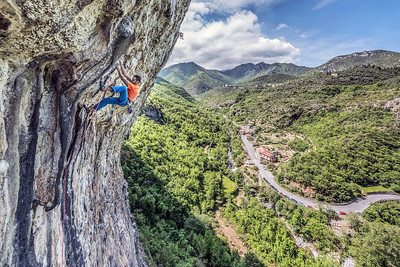 Climbing Vulneraria at Erboristeria Alta in Finale