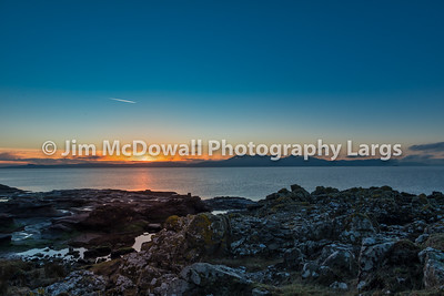 Sun Going Down Behind the Isle of Arran from Portencross North Ayrshire on a Cold Christmas Eve Sunset