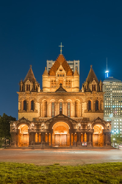 Dusk falls on Boston as Trinity Church shines in Copley Square.