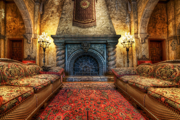 """The Fireplace in the Tower of Terror I've always wanted to get """"behind the velvet rope"""" and take proper photos of this area, and it finally happened!  This lobby was richly decorated to look like an old, classic Hollywood hotel that has been left alone to slowly deteriorate. Although this angle in particular does not show the decay, future ones will... Also, a future one will include the full story of how I got behind the velvet rope -- you won't believe it!  - Trey Ratcliff  Read the rest here at the Stuck in Customs blog."""