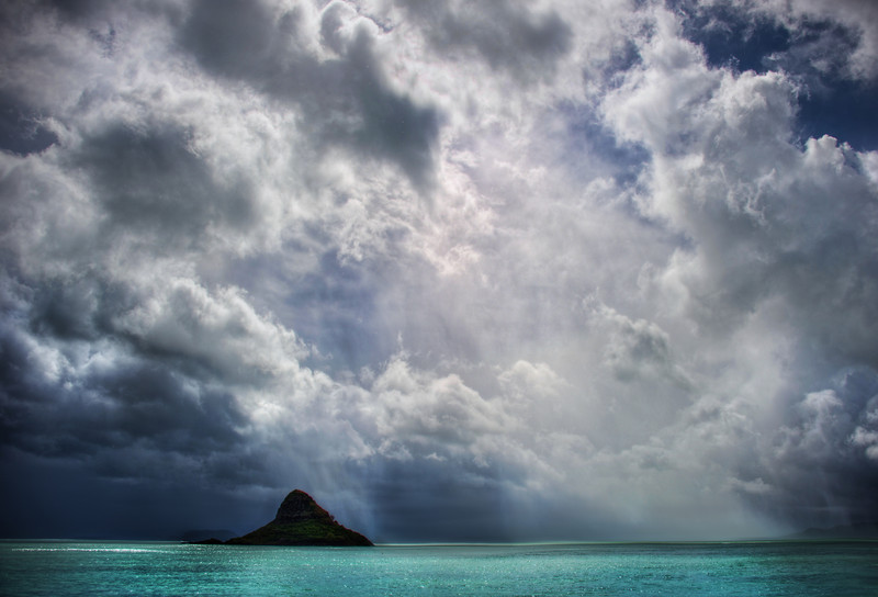 "<h2>Chinaman's Hat</h2> <br/>Also known as Mokolii, this distinctive island seems to stay in your view for a few hours as you go along the coast of Oahu.<br/><br/>EXIF-hunters will notice that I used my D3S to take this photo instead of my D3X.  I had to give that D3X a rest after getting it too wet over the previous four days of rainfall.  In fact, this was the first opening of the skies after an endless torrent of water and storm.  I was so happy to see some dynamic skies and be in the perfect spot when it happened…<br/><br/>- Trey Ratcliff<br/><br/><a href=""http://www.stuckincustoms.com/2012/03/19/chinamans-hat/"" rel=""nofollow"">Click here to read the rest of this post at the Stuck in Customs blog.</a>"