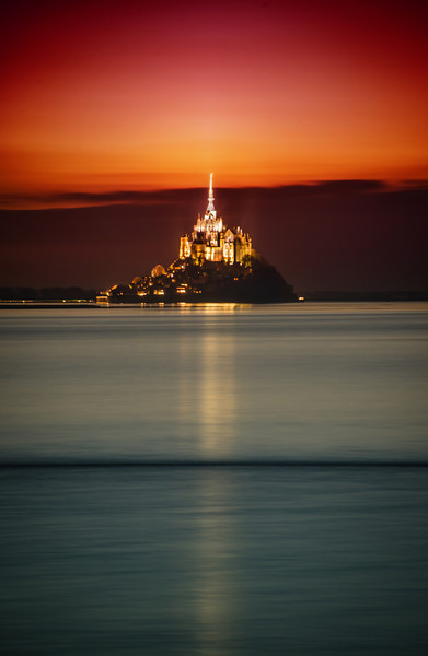 Mont Saint Michel After Paris, I rented a car with Tom and we drove off through France through Normandy. We finally arrived at this magical place — an amazing location I've always wanted to visit.It's a huge fortified monastery atop a fortified and walled city. At low-tide, you can walk out across the sand to get there, but in high tide, it becomes an island. Is there anything more awesome? I don't think so!- Trey RatcliffClick here to read the rest of this post at the Stuck in Customs blog.