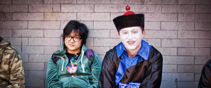 "<h2>Painted Face in China</h2> <br/>I was walking along outside the Forbidden City trying to find a special entrance, and I saw these guys sitting on a bench. It was so interesting and amusing… I dropped down on a knee to take a quick photo while things were perfectly strange. What do you think is going on in this photo?<br/><br/>- Trey Ratcliff<br/><br/><a href=""http://www.stuckincustoms.com/2011/11/18/painted-face-in-china/"" rel=""nofollow"">Click here to read the rest of this post at the Stuck in Customs blog.</a>"
