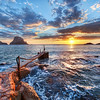 "<h2>The Last Sunset</h2> <br/>It was one of those perfect sunsets where time went in slow motion.  I was on high-alert, and kept everything flowing as I moved from location to location.  It's not easy to dance across rocks with the tripod fully extended, but it certainly is memorable!<br/><br/>I saw this dock early in the day, and I was secretly hoping that it might just point towards the sun as it passed the horizon.  So I had this shot planned along with about 10 others.  Some worked out and some didn't.  This is one of the ones that worked out.<br/><br/>- Trey Ratcliff<br/><br/><a href=""http://www.stuckincustoms.com/2011/02/17/the-last-sunset/"" rel=""nofollow"">Click here to read the rest of this post at the Stuck in Customs blog.</a>"