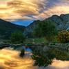 "<h2>The Pond and the Sunset Stormclouds</h2> <br/>I had a wonderful evening with Eden Brackstone, even though he uses a Canon.  I can overlook these trifle matters, but I do not forget them lightly.<br/><br/>We were in Gibbston, New Zealand, about 20 minutes from Queenstown.  After a wonderful dinner with his delightful family, I popped out onto his farm to shoot some HDR.  He started recording video on his aforementioned Canon-thing, and put together the little dealio at the link below.  Enjoy!<br/><br/>Here is the final photo that was taken just before I we started recording the video.<br/><br/>- Trey Ratcliff<br/><br/>See the video <a href=""http://www.stuckincustoms.com/2010/11/10/new-video-on-edens-farm/"">here</a> at Trey Ratcliff's travel photography blog, Stuck in Customs."