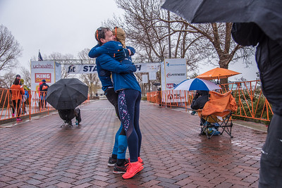 Nicole Siskey and Jonathan Torney celebrate with a hug after crossing the finish line of the Broncos Fit 7K on Saturday, April 21, 2018, at the Budweiser Brewery Experience in Fort Collins.