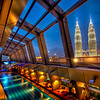 "<h2>The Sky Bar in Kuala Lumpur with a View of Petronas</h2> <br/>This bar is up on top of the roof and it is all open air. There is a pool down there that is always available for use, and it is surrounded by a ultra-chic bar. It was raining when I took this… I am up on the 2nd level of the bar, where there is a spa… you can see the little massage rooms down the lefthand side there.<br/><br/>- Trey Ratcliff<br/><br/><a href=""http://www.stuckincustoms.com/2008/03/20/the-open-air-sky-bar-in-kuala-lumpur-with-a-view-of-petronas/"" rel=""nofollow"">Click here to read the rest of this post at the Stuck in Customs blog.</a>"