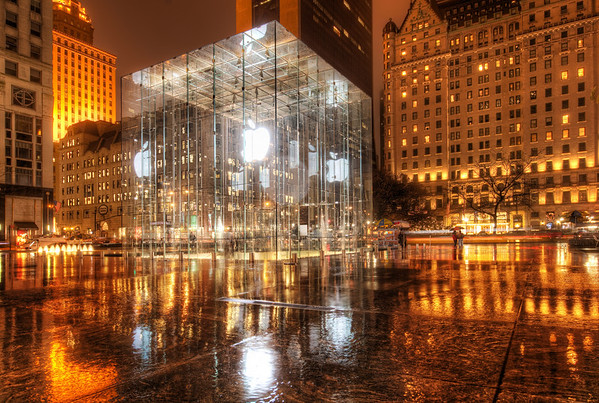Apple Store, New York This store is pretty awesome, isn't it?  I was just showing this photo to the architect Eric Kuhne (who gave an awesome presentation at EG about futuristic city design - will link soon), and we both had the same reaction to this place...  smart and awesome.I always wanted to take a photo from this angle and thought about it ever since the first time I visited.  I was happy with the rain, because it made it all feel right.  Even better, I was standing under an arch so I was perfectly dry...  these kind of shots out in the rain with the 14-24 are tough because of the bulbous lens.  It's not a problem if the rain is straight down, but it never is!Lisa Bettany has an upcoming PhotoWalk starting from this location, and I am sure she will mention more today on the live show.- Trey RatcliffClick here to read the rest of this post at the Stuck in Customs blog.