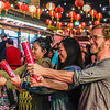 John Chaides / Courier<br /> Julia Zhu, left, Sophia Phillips, middle, and Jesse Phillips, right, celebrate the moon festival by popping confetti poppers at Chinatown Central Plaza, Los Angeles on Saturday, October 7, 2017. Many people shot off poppers in celebration of the festival.